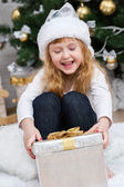 Child under the Christmas tree — Foto de Stock