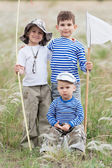 Fishermen on meadow — Stock Photo