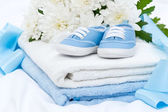 Booties and towel — Stock Photo