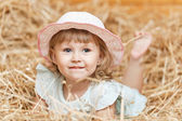 Young girl lying in the manger — Stock Photo