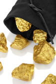 Gold nuggets in a bag — Stockfoto