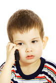 Little boy communicates by the phone — ストック写真