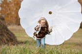 Girl with parachute — Stock Photo