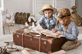 Boys traveler fill their travel book — Stock Photo