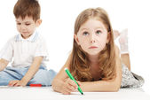 Little boy and girl draws — Foto de Stock