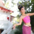 Thai dancing girl with northern style dress in temple — Stock Photo #45200567