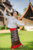 Thai dancing girl with northern style dress in temple — Stockfoto
