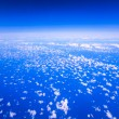 Beautiful cloudy sky view from air plane window — Stock Photo