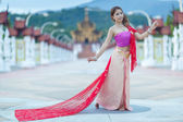 Thai dancing girl with northern style dress in temple — Stock Photo