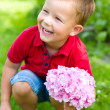 Little boy with flowers — Stock Photo #38832697