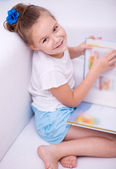 Little girl reads a book — Stock Photo