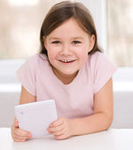 Girl using tablet — Stock Photo