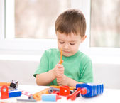 Boy is playing with tools — Stock Photo