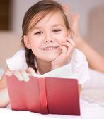Little girl is reading a book — Foto de Stock