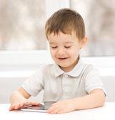 Boy using tablet — Stock Photo