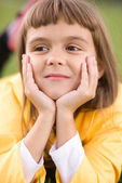 Little girl is daydreaming — Stock Photo