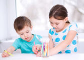 Little children is drawing on white paper — Stock Photo