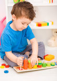 Boy is playing with building blocks — ストック写真