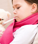 Little girl with thermometer in her mouth — Foto de Stock