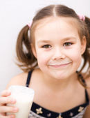 Little girl with a glass of milk — Stock Photo