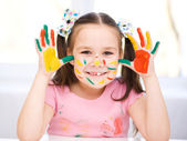 Portrait of a cute girl playing with paints — Fotografia Stock