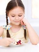 Little girl is eating ice-cream — Stock Photo