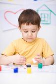 Portrait of a cute boy playing with paints — Foto de Stock