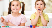 Children are painting with paint — Stock Photo
