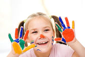 Portrait of a cute girl playing with paints — Stock Photo