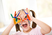 Portrait of a cute girl playing with paints — Stockfoto
