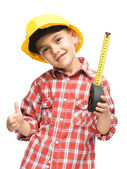 Boy as a construction worker with tape measure — ストック写真