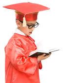 ładny chłopiec trzyma książki — Zdjęcie stockowe