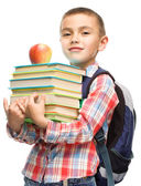Cute boy is holding book — Stockfoto