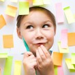 Cute girl with lots of reminder notes — Stock Photo #46215085