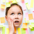 Cute girl with lots of reminder notes — Stock Photo #46349061