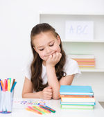 Cute girl is drawing using pencils — Stock Photo