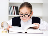 Cute girl is reading book — Stock Photo