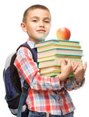 Cute boy is holding book — Stock Photo