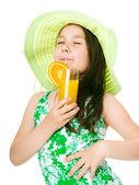 Cute girl is drinking orange juice — Stock Photo