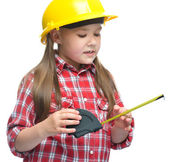 Girl as a construction worker with tape measure — Stock Photo