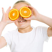 Girl with oranges — Stock Photo