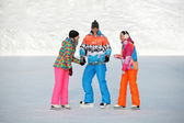 Young people, friends, winter ice-skating on the frozen lake — Stock Photo