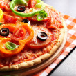Vegetarian pizza with peppers, tomatoes, olives and basil — Stock Photo #38890043