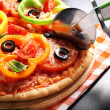Vegetarian pizza with peppers, tomatoes, olives and basil — Stock Photo