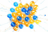 Colourful balloons with golden and blue streamers isolated on wh — Stock Photo
