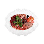 Cold cuts, on a plate (white background) — Stockfoto