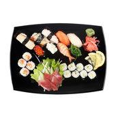 Set of sushi on plate isolated on white — Stockfoto