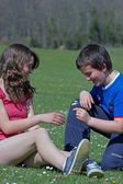 Teenage boy and girl in the nature on beautiful day — Стоковое фото