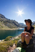 Mountain landscape with lake and girl — Stock Photo