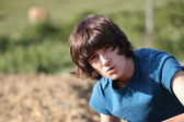 Teenage boy in the nature on beautiful day — Stock Photo
